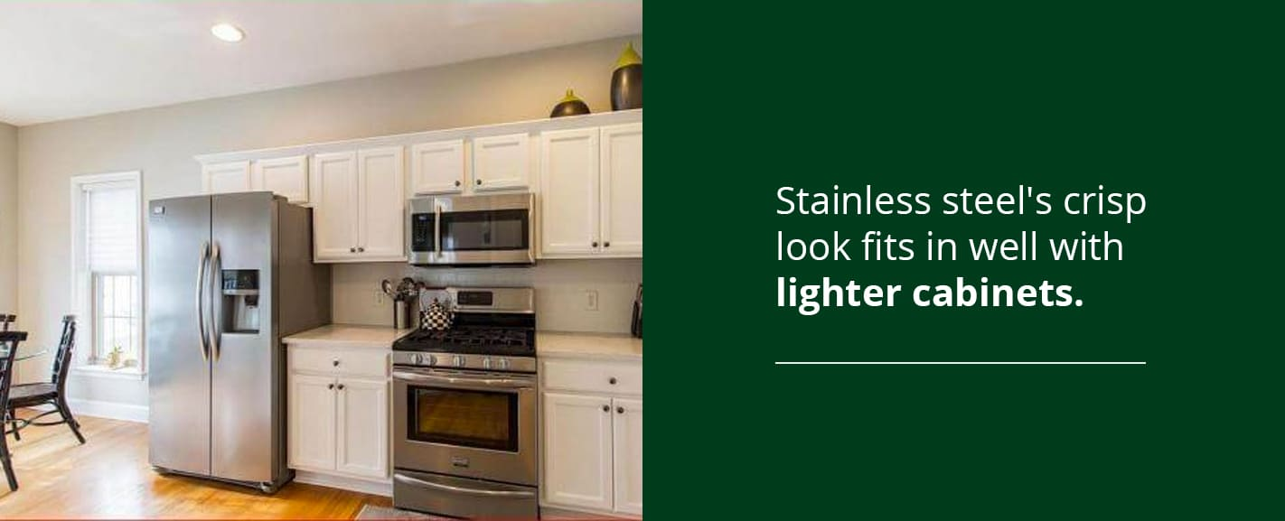 Stainless steel's crisp look fits in well with lighter cabinets
