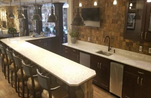 Alcove Kitchen With White Countertops and Dark Wood Cabinets