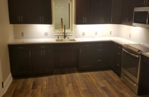 White Kitchen Countertops Paired With Dark Wood