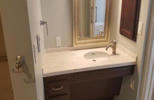Vanity With Side Faucet In Bathroom