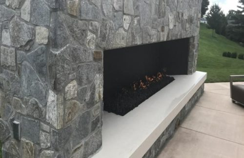 Hearth and Firebox In Outdoor Lounge Area