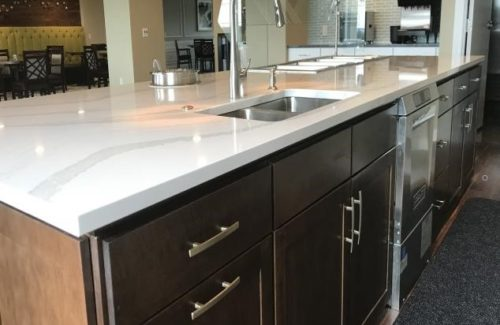 White Marbled Island Top With Dark Brown Cabinets
