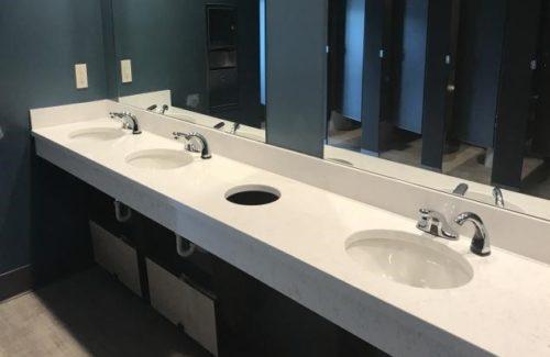 Corian Quartz Coarse Vanity In Restroom