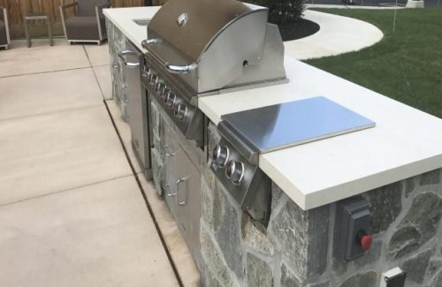 White BBQ Countertop Outside With Grill