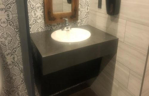 Dark Gray Vanity In Bathroom