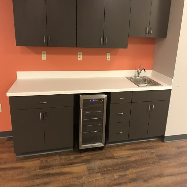White Countertop With Rectangular Sink In Office Kitchen Area