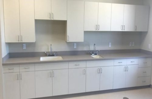 Gray Countertops With White Cabinets In Kitchen Area