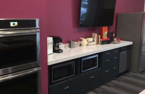 White Countertop In Office Kitchen Area