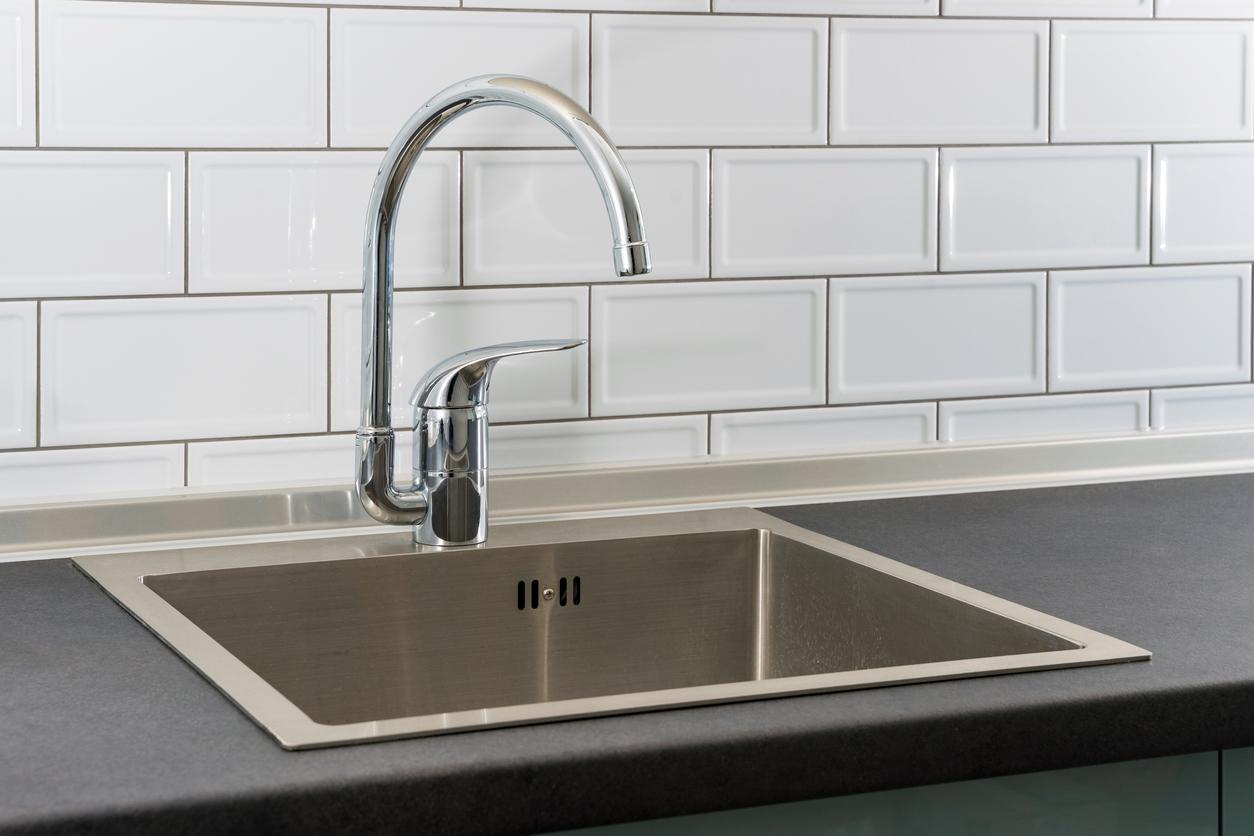 Kitchen Sink and Water Tap In Modern Apartment Kitchen