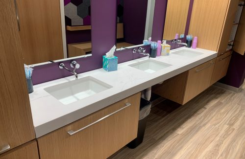 White Countertop With Sinks In Purple Bathroom